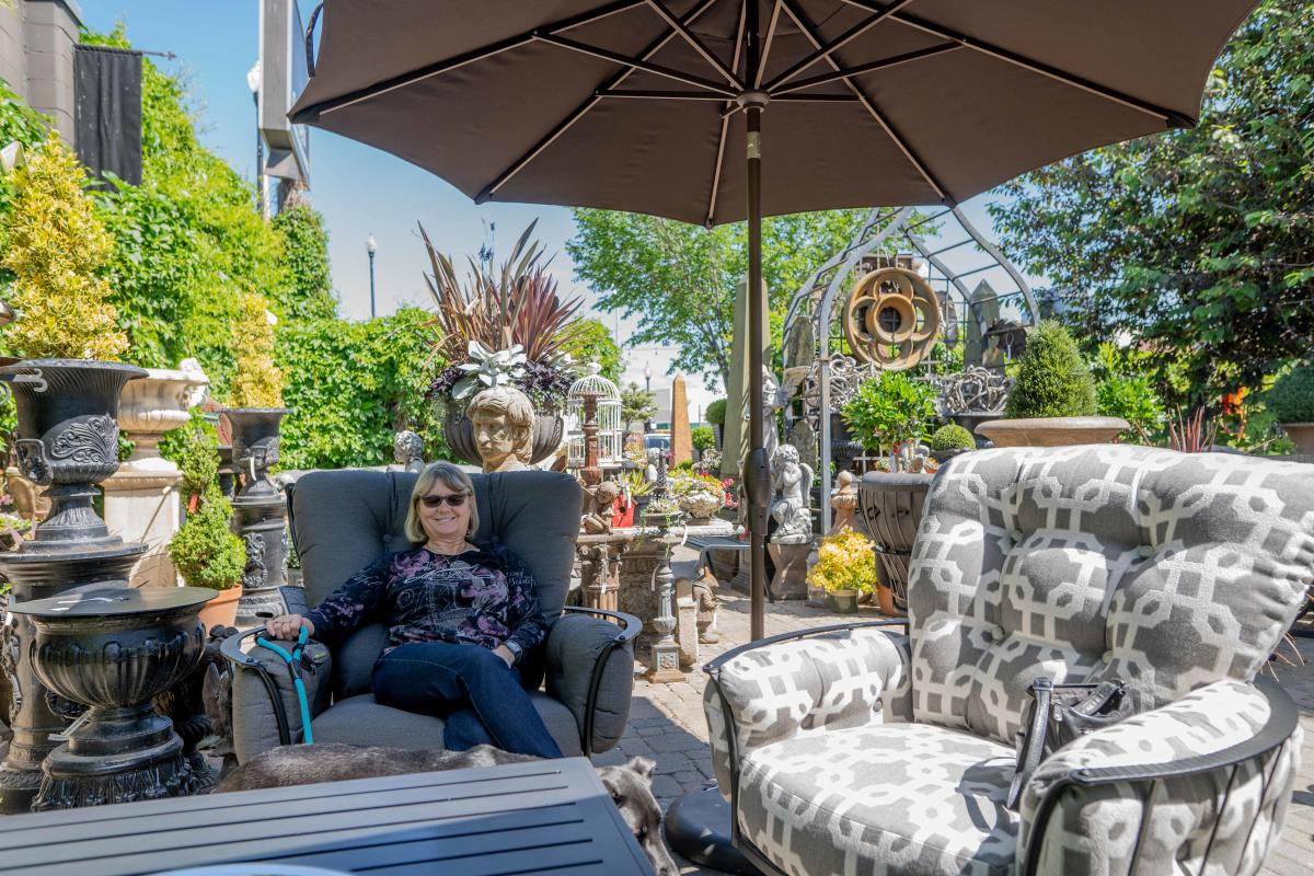 Woman Sitting in Lounge Chairs at Garden Architecture & Design in Saskatoon