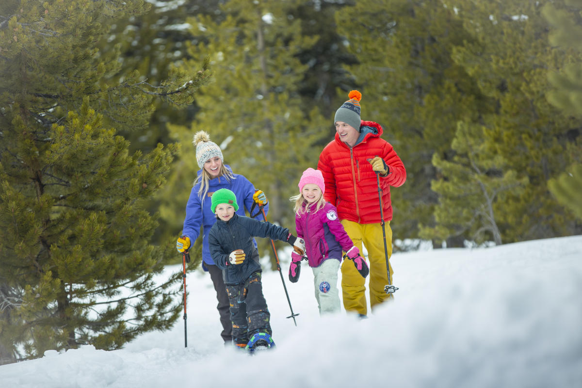 A family enjoys snowshoeing in the winter in Steamboat Springs, Colorado