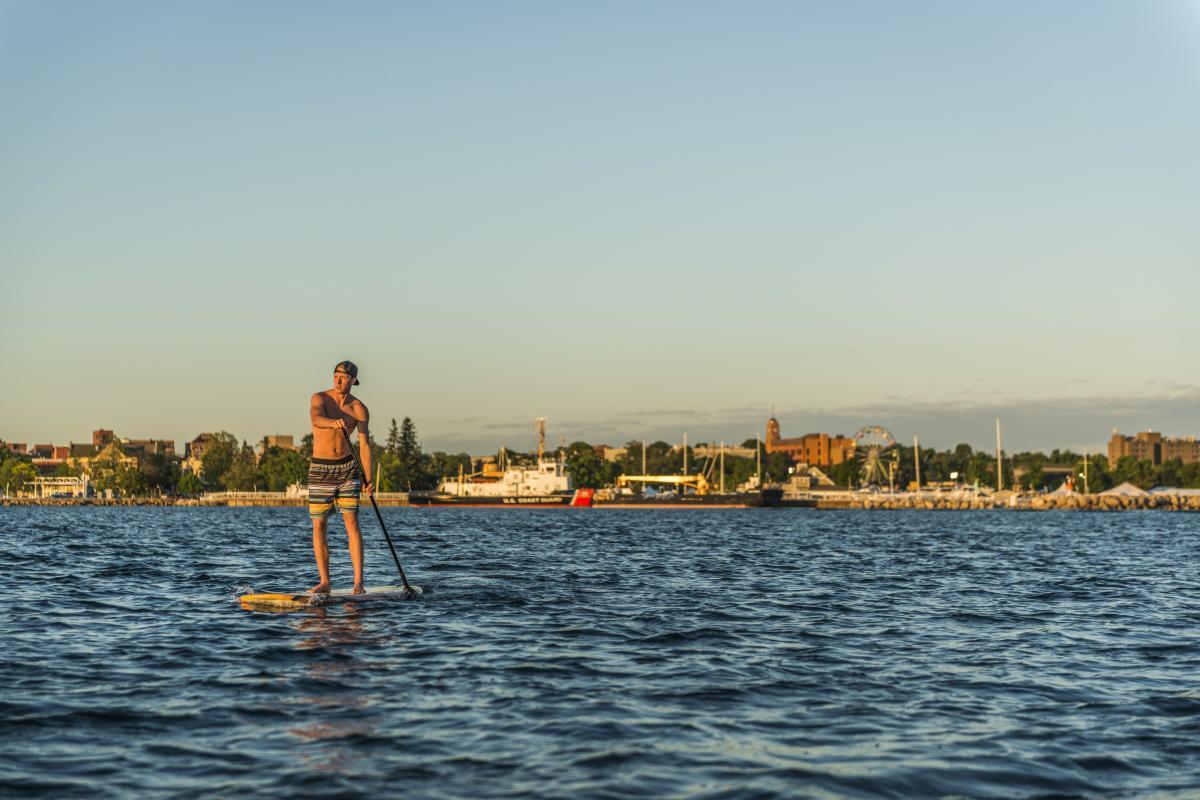 Paddle boarding Traverse City West Bay Beach