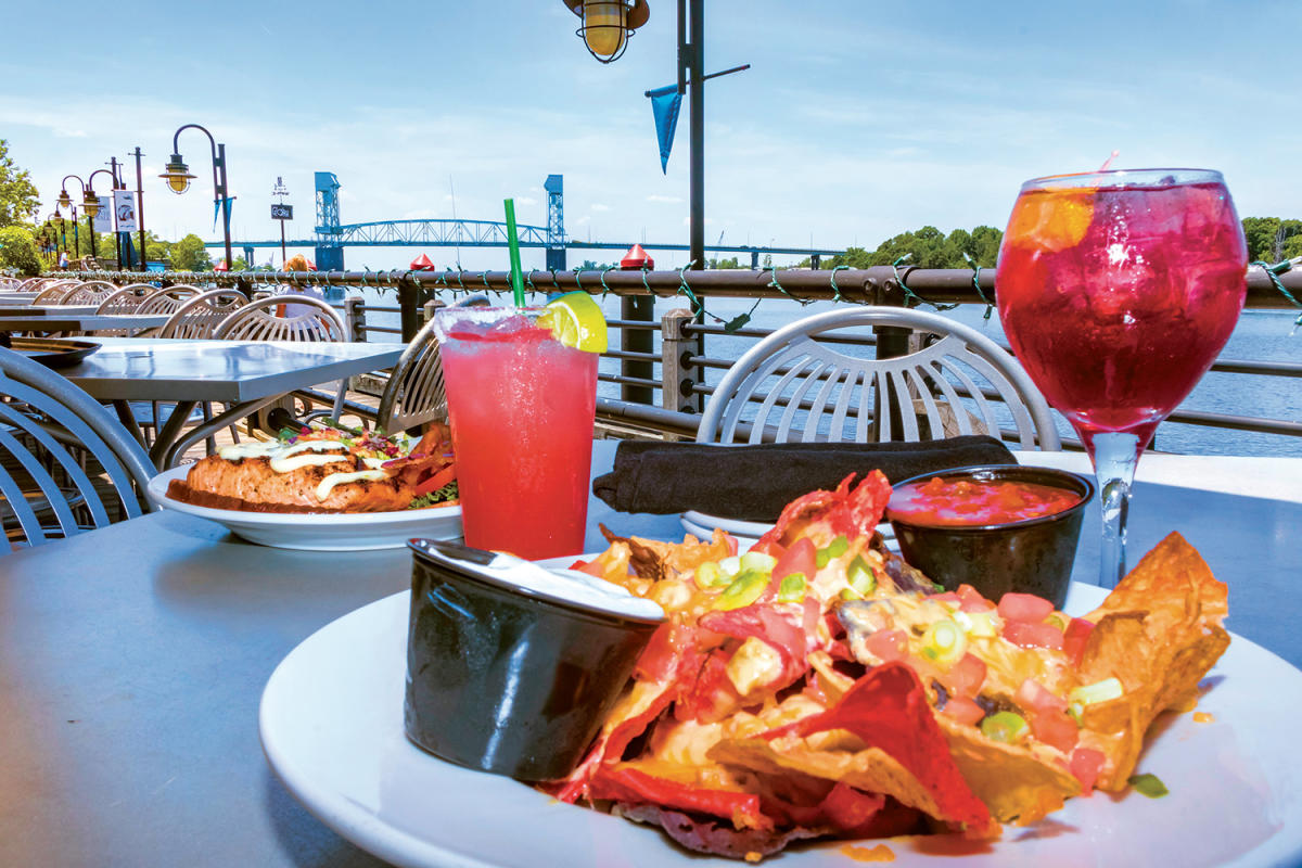 Outdoor dining at The George in Wilmington, NC