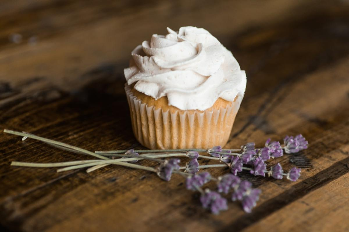 white icing-covered cupcake