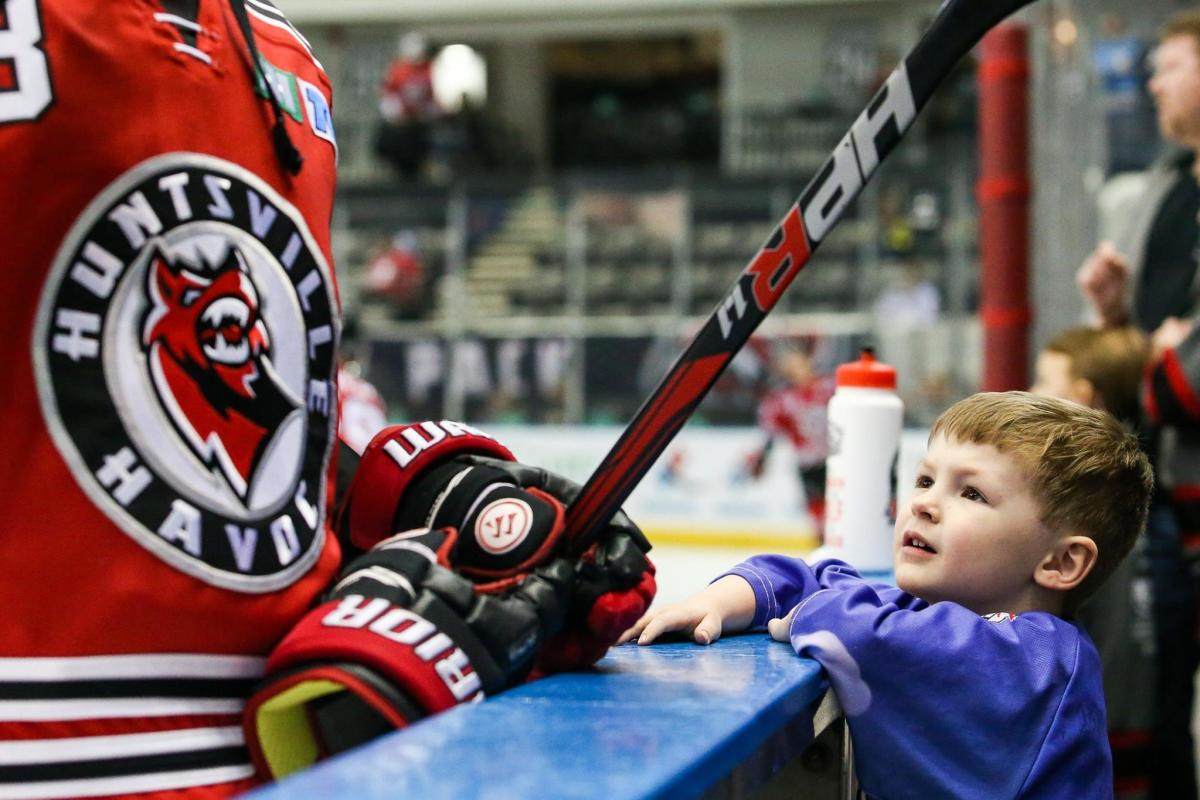 Child and Huntsville Havoc hockey player