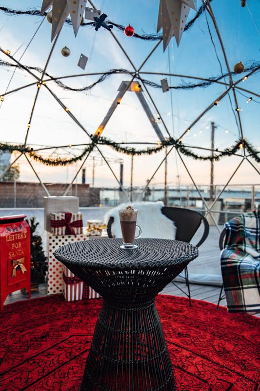 Gurney's Igloos Interior With Hot Chocolate on Table