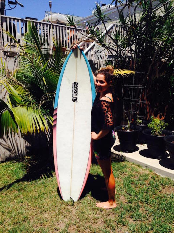 Jamie with her surfboard shaped by Rockin' Fig