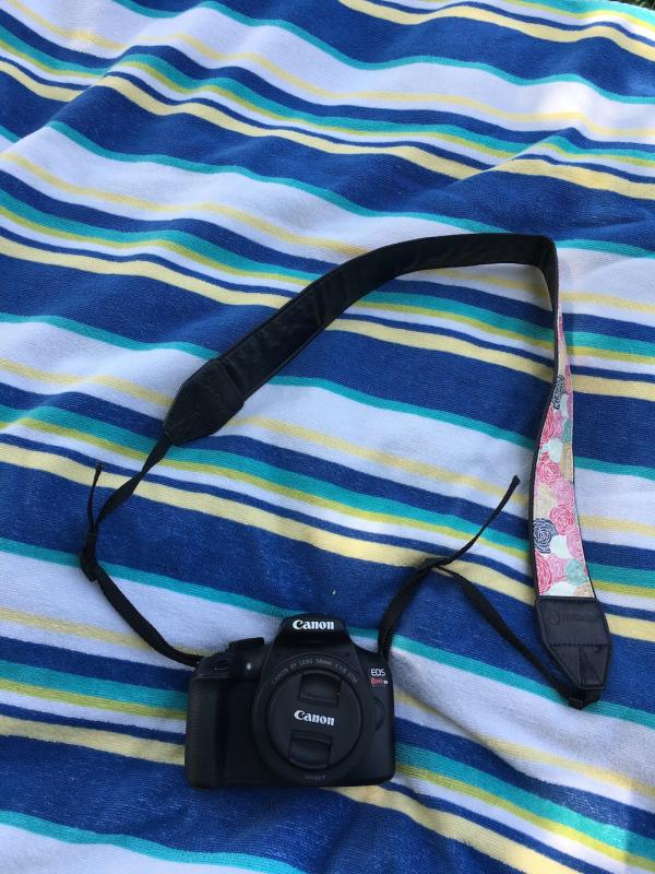 Camera on beach towel for day trip to Big Falls