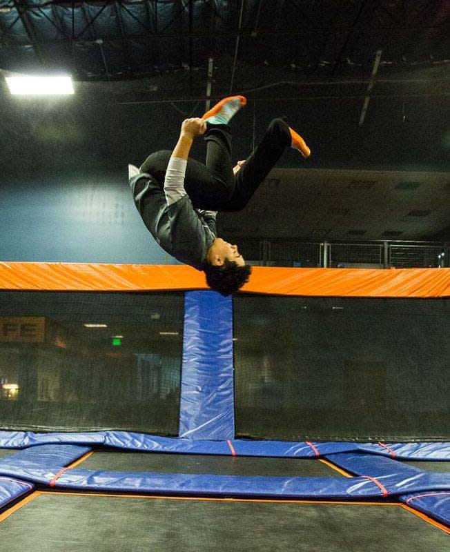 Boy doing backflip on a trampoline at Sky Zone in Lafayette