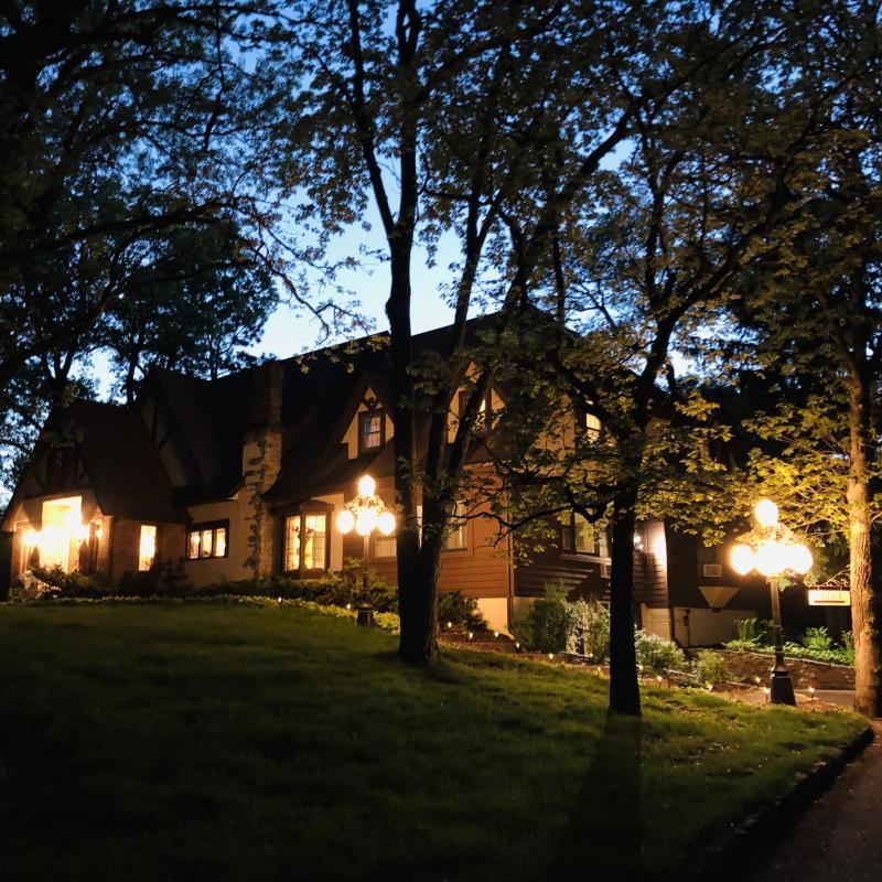 The exterior of the Otter Creek Inn at dusk.
