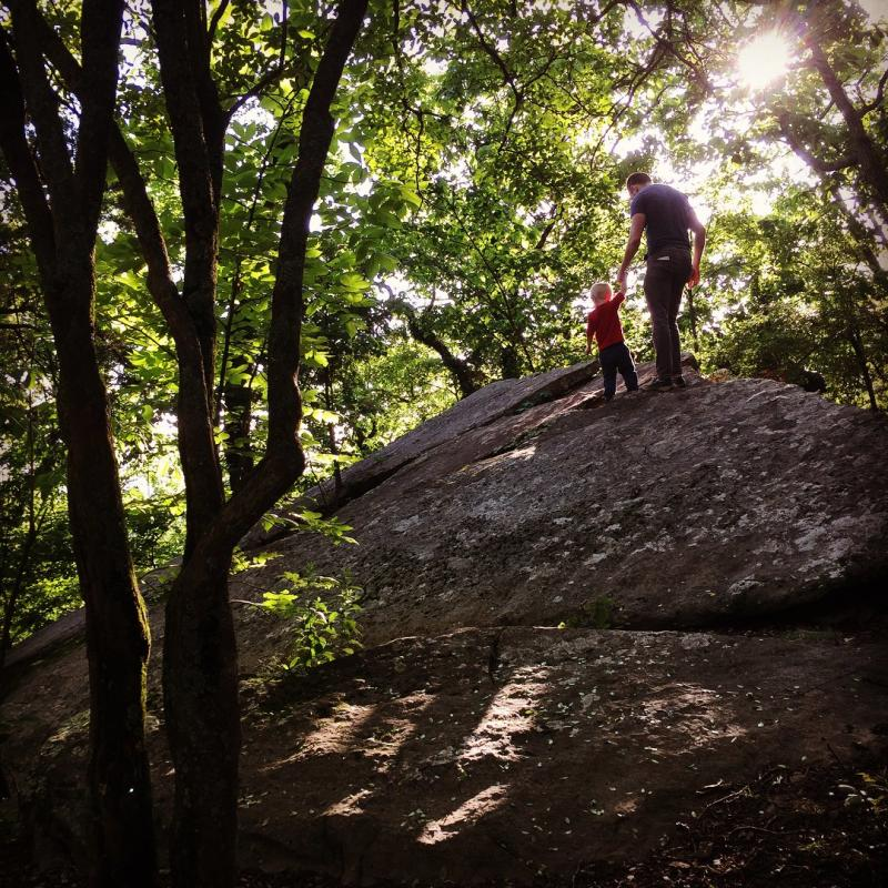 Father and Son Hiking on large rock