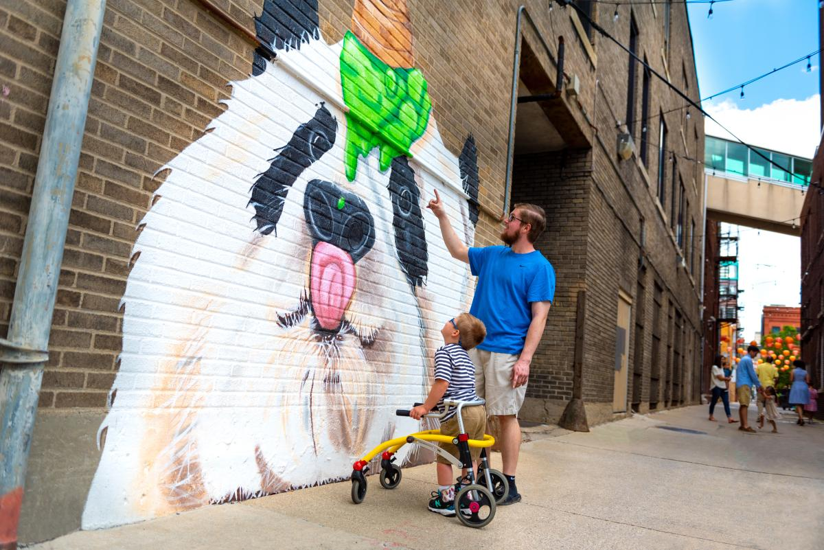 Father and son enjoying the panda mural in Fort Wayne, Indiana.