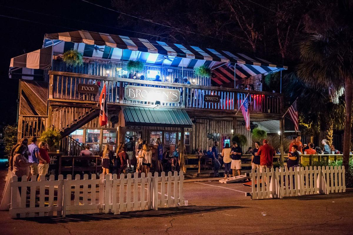 Patrons gathered for outdoor drinks and food at Brogen's South on St. Simons Island, GA at night
