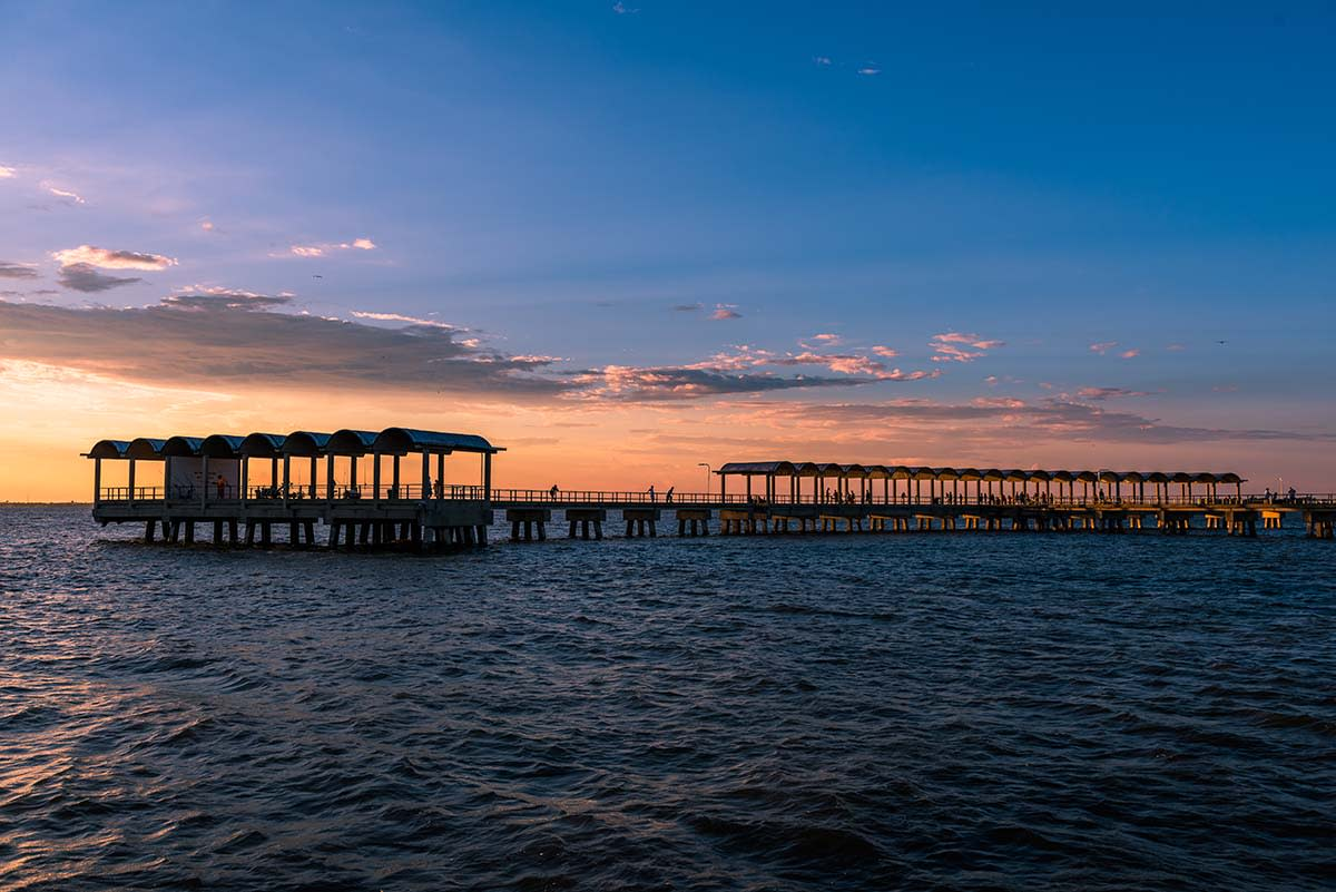 The iconic Jekyll Island Pier is a beloved waterfront attraction for families, fishermen and those looking for beautiful views | Jekyll Island, GA
