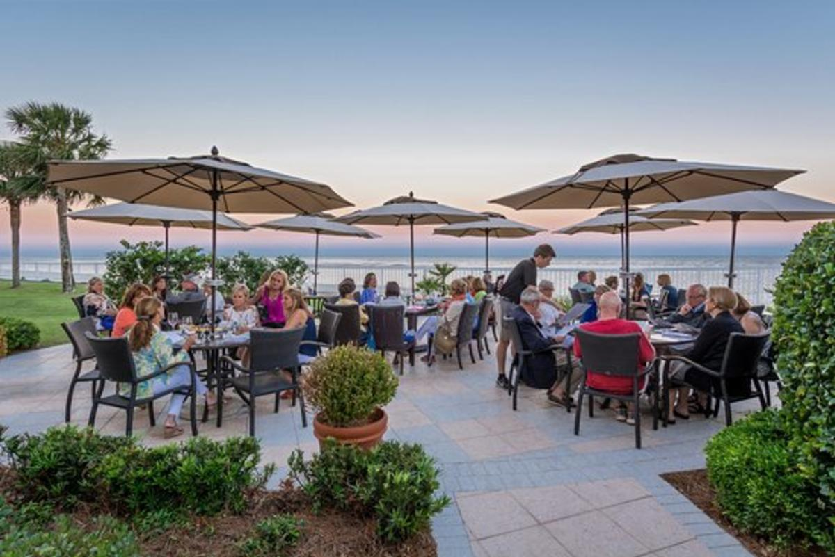 Patrons seated for oceanfront outdoor dining at ECHO restaurant on St. Simons Island, GA