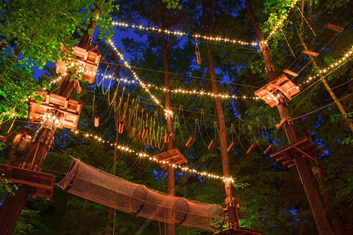 Frankenmuth Aerial Park at night with string lights and a rope tunnel