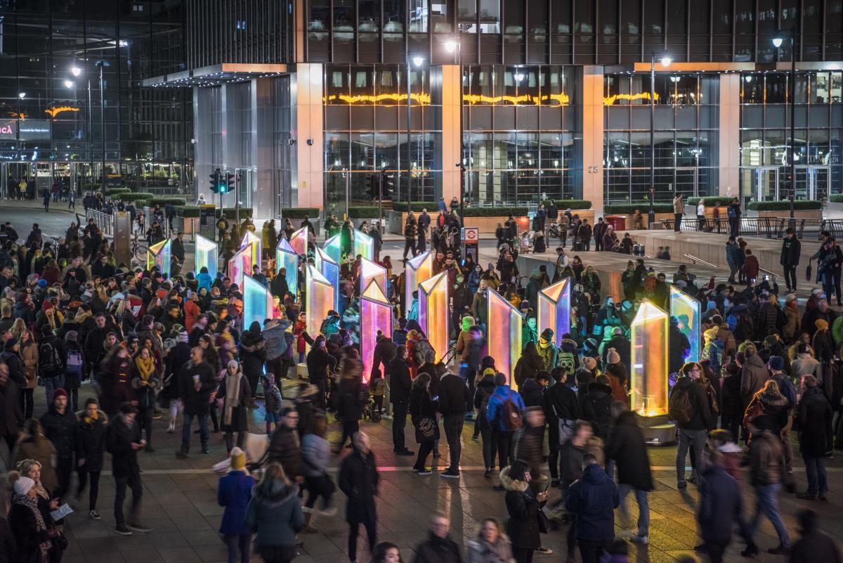 Visitors enjoy the lights of Prismatica at night