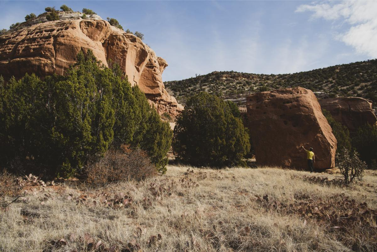 Hubert d'Autremont explores a boulder near the Mills Canyon Rim Campground, New Mexico Magazine