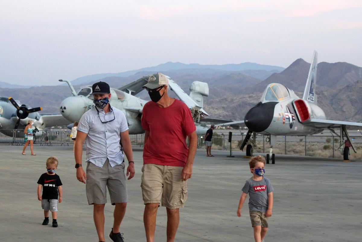 Family visiting the palm springs air museum with masks.