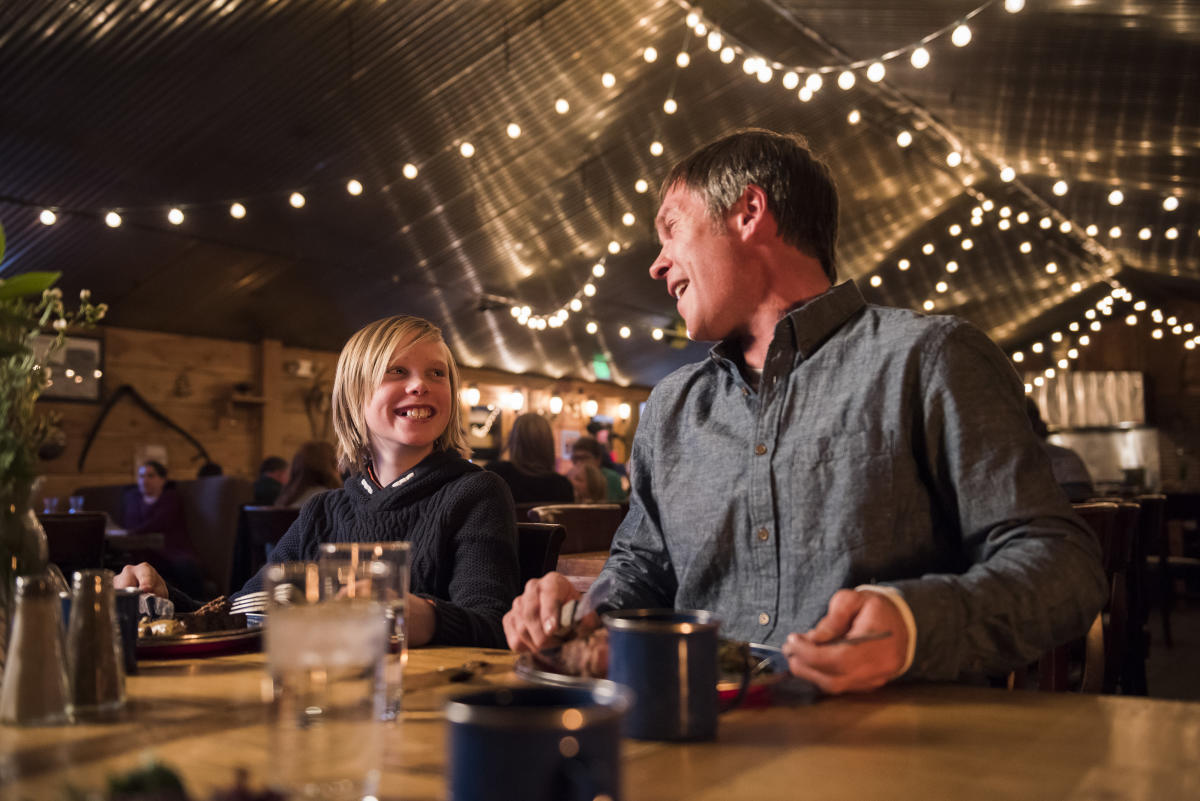 Family eating in a Yurt after sleigh ride