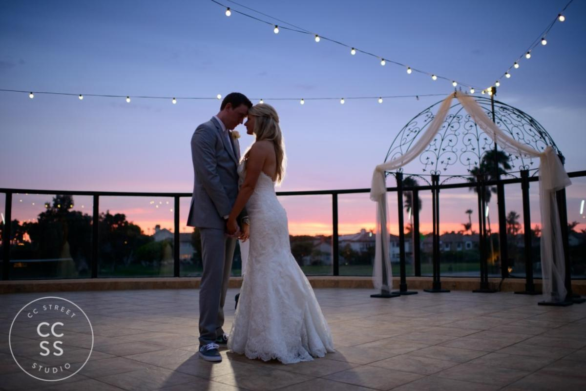 Bride and Groom holding hands at sunset in Huntington Beach