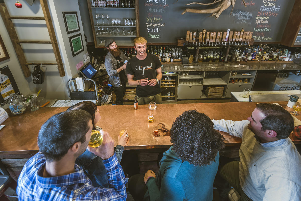 Group drinking cider at Taproot