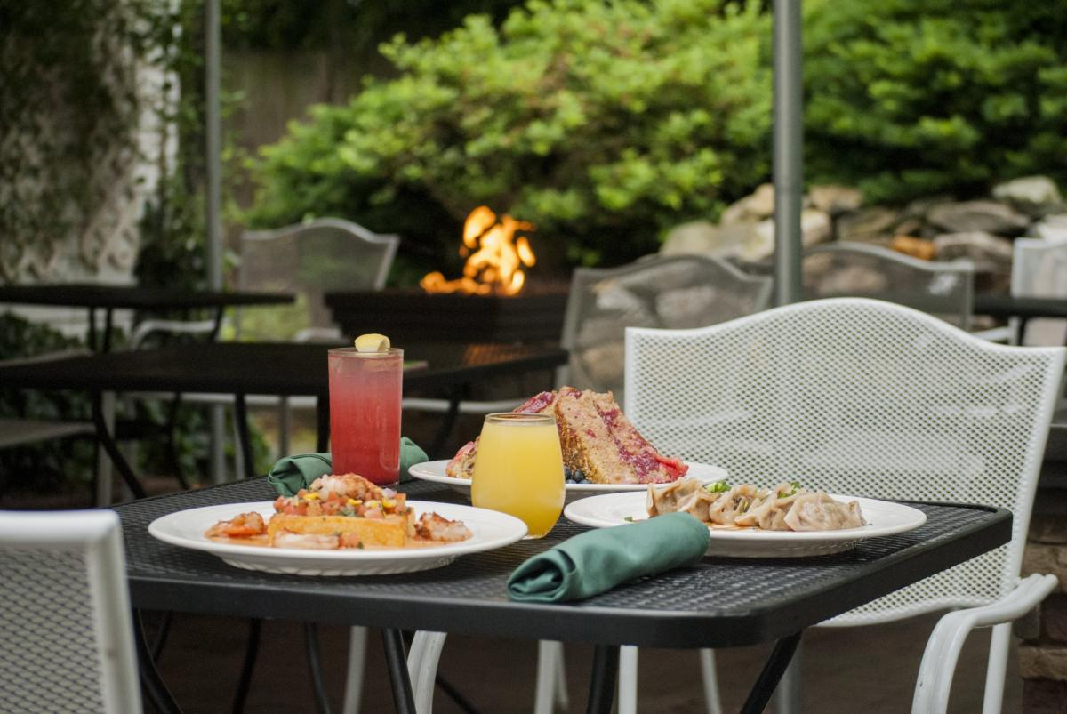 outdoor meal and seating at the Secret Garden Cafe