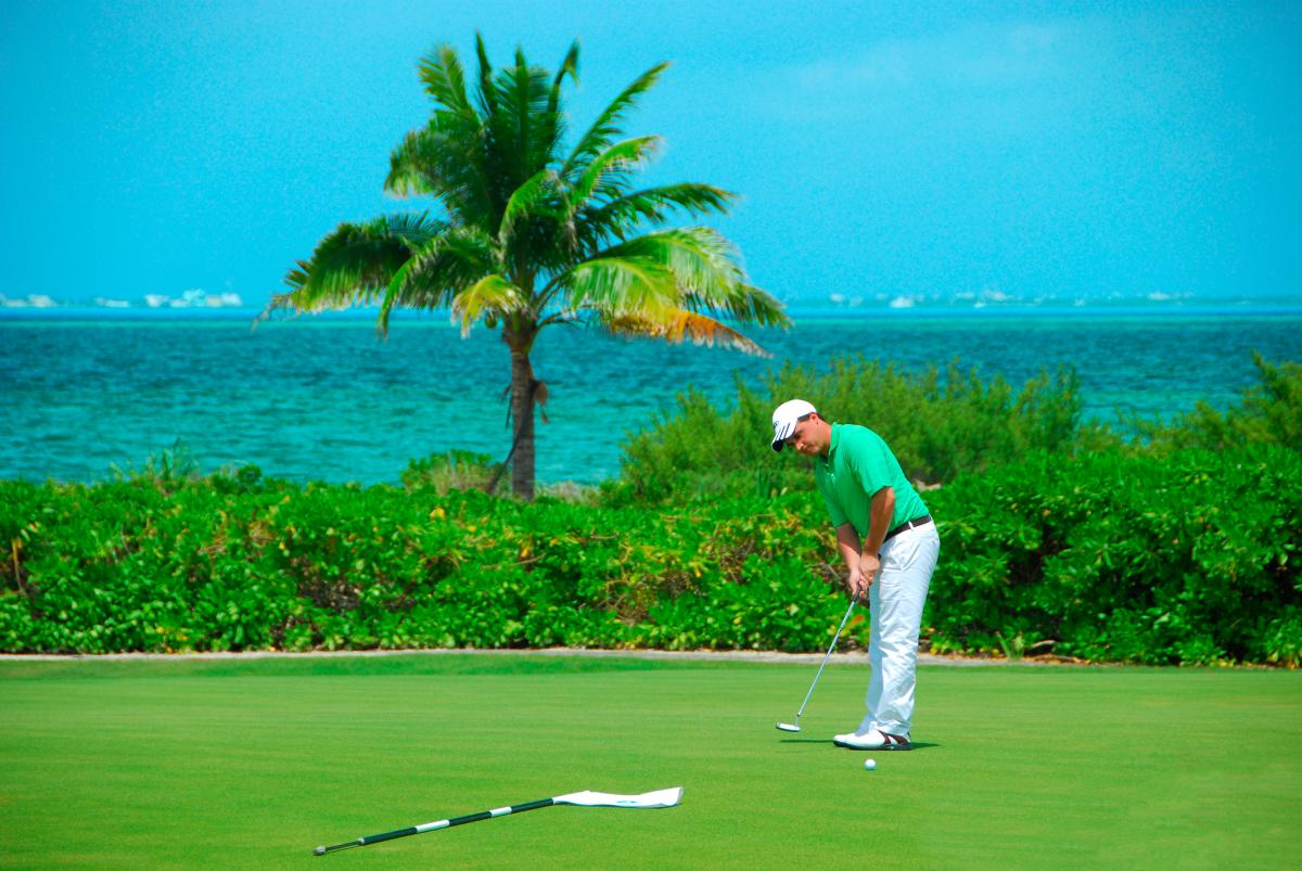 Golfer Putting by Ocean