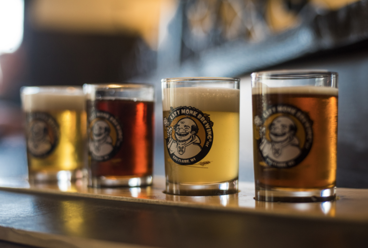A close-up shot of Lazy Monk glasses filled with different beers