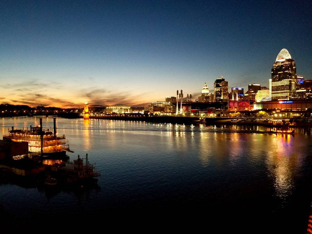 Sunset over the Ohio river with the Cincinnati and BB Riverboat