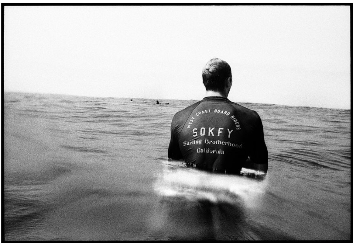 Surfer wearing West Coast Board Riders shirt made by SOKFY