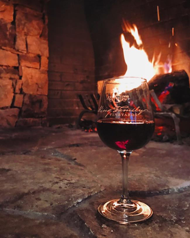 Wine Glass by Fireplace