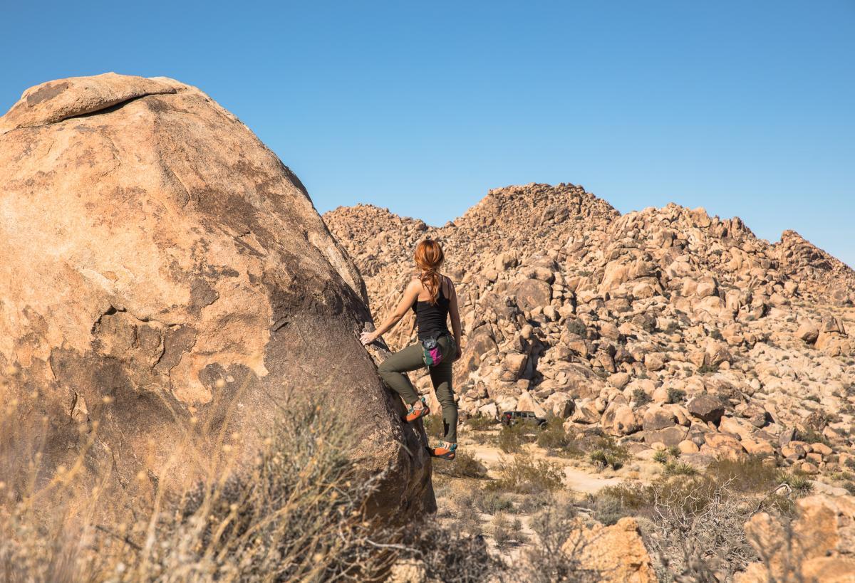 Woman rock climbing in Joshua Tree National Park