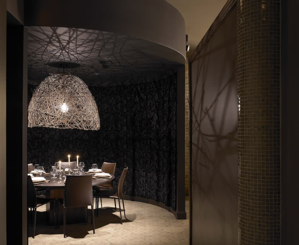 Private dining space with round table at Sepia restaurant in Chicago