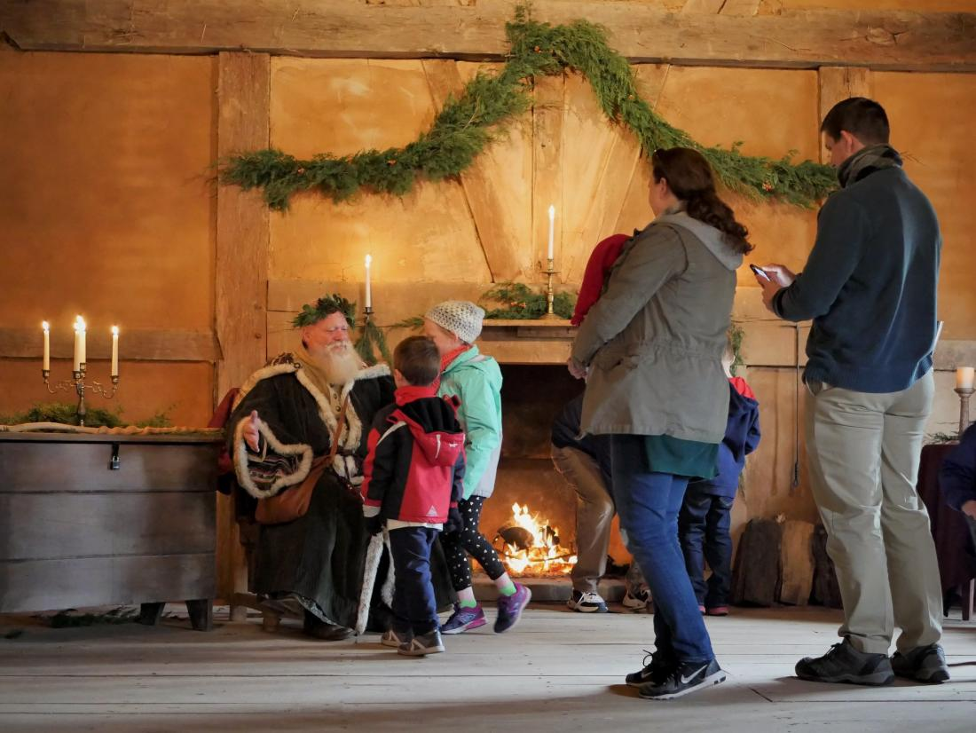 Henricus Historical Park Father Christmas greeting a family