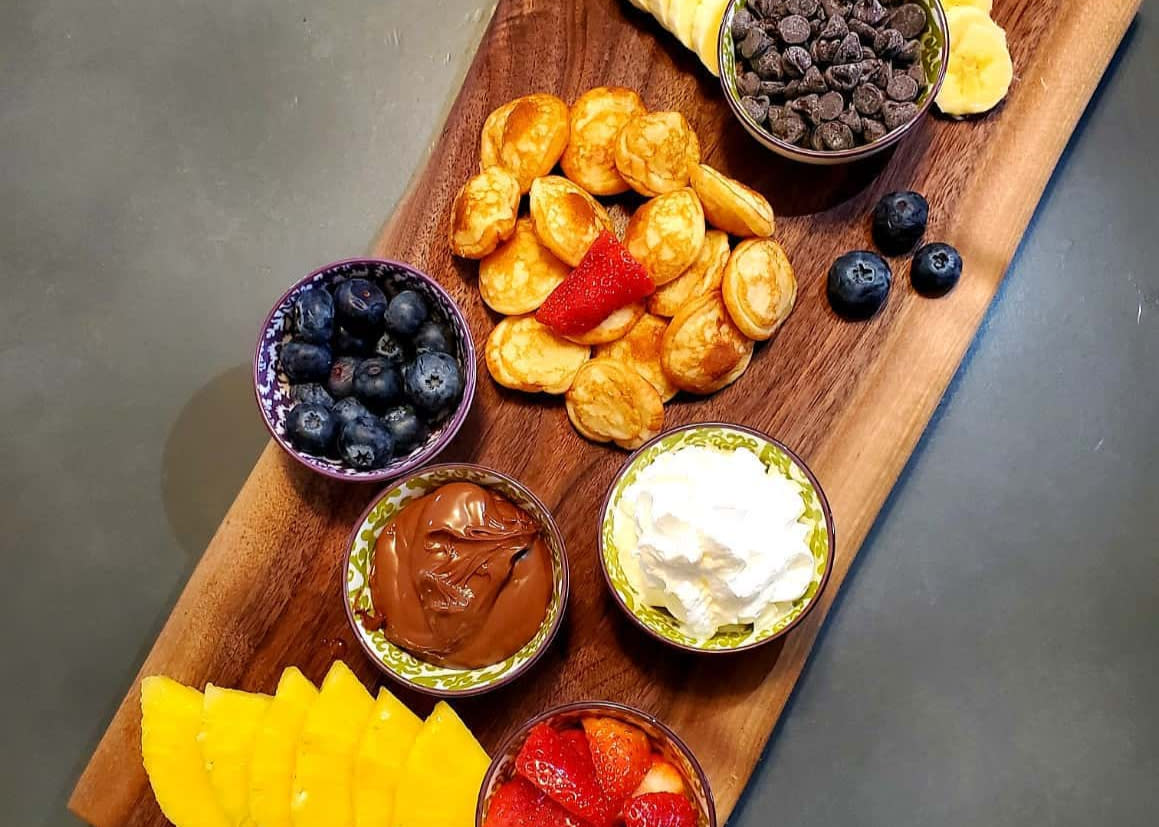 The Spot on Mill Street Pancake Platter, includes pancakes, chocolate chips, a variety of fruit and spreads