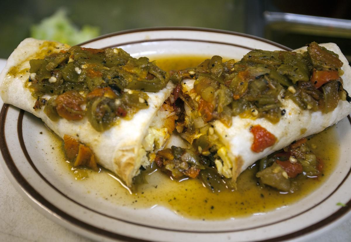A breakfast burrito topped with fresh-roasted New Mexico hatch chilies.