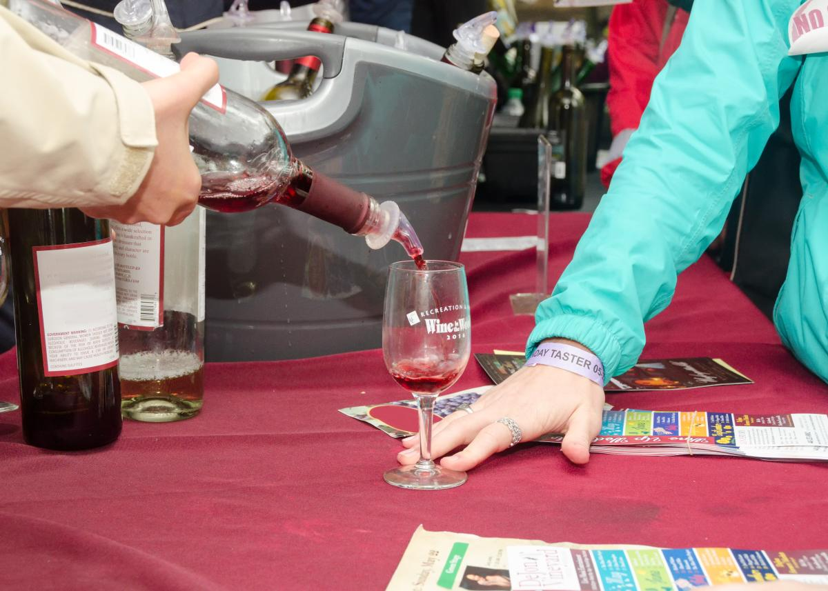 Pouring a taste at Wine in the Woods