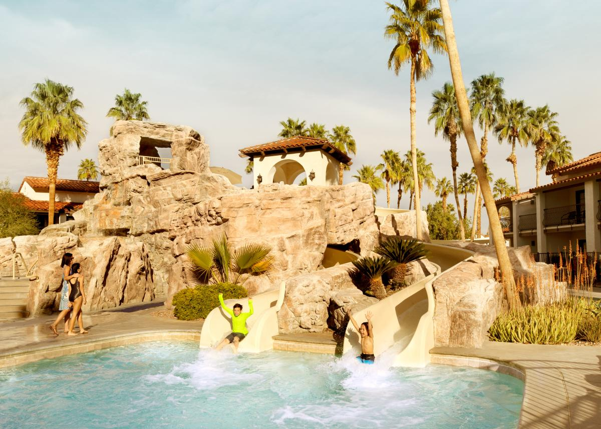 Kids enjoy the water slides at Splashtopia at Omni Rancho Las Palmas Resort & Spa.