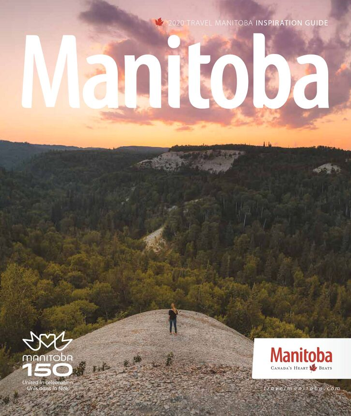 Cover of the 2020 Travel Manitoba Inspiration Guide featuring a person on Bald Hill, Riding Mountain National Park