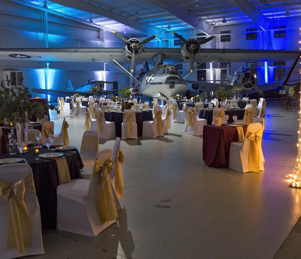 Gold & Black Tables Navy Hangar