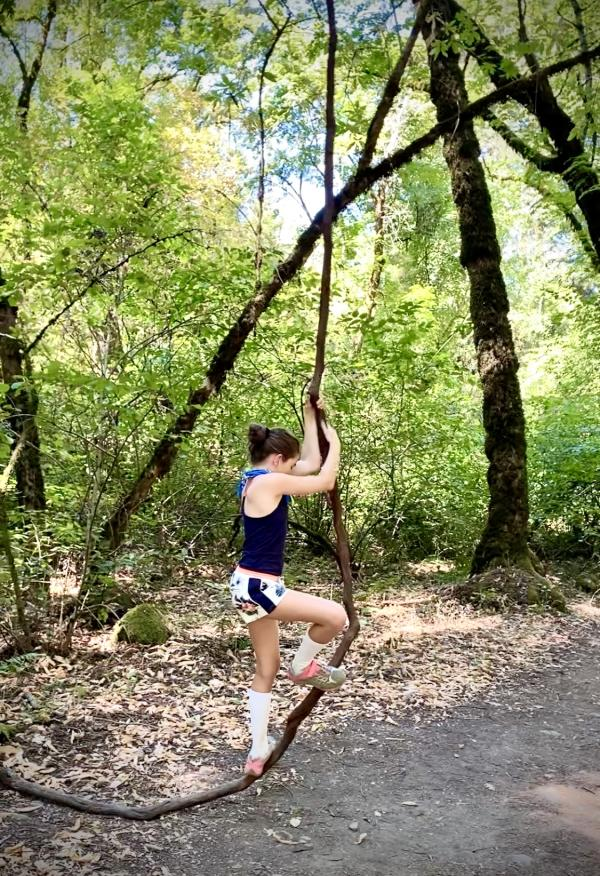 A woman tests her balance on a branch at Bothe Napa State Park near St Helena.