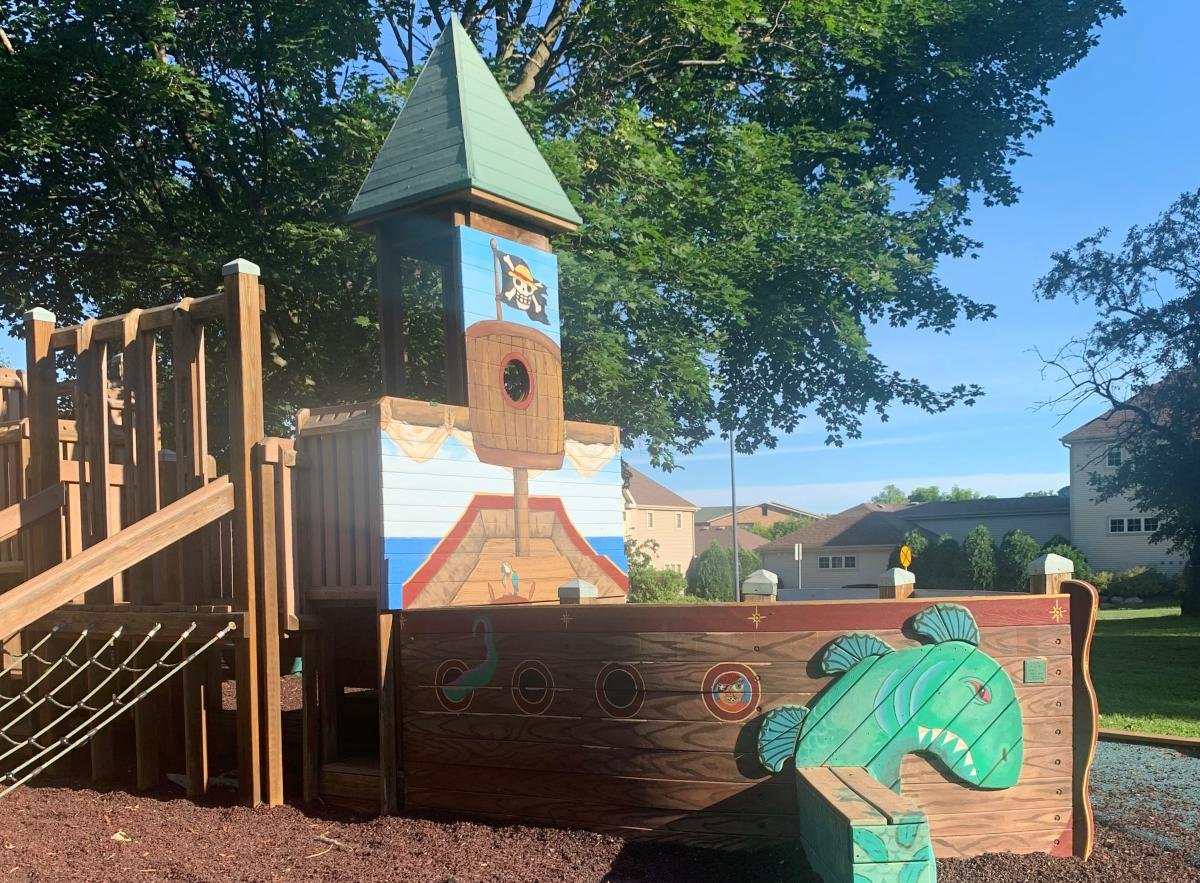 Wooden pirate ship within a playground