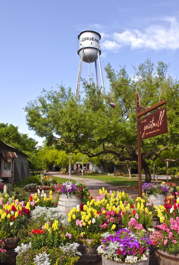 Gruene Tower and Gristmill restaurant sign with flowers