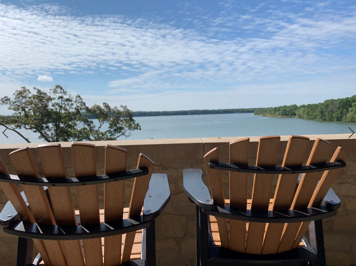 Water view over Adirondack chairs at Deer Creek
