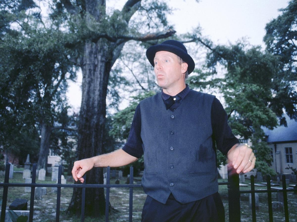 A ghost tour guide speaking at St. James cemetery in Wilmington, NC
