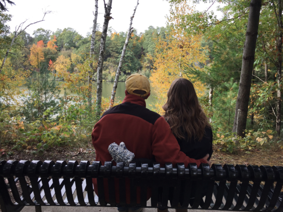 A couple on a bench overlooking the view at Carson Park