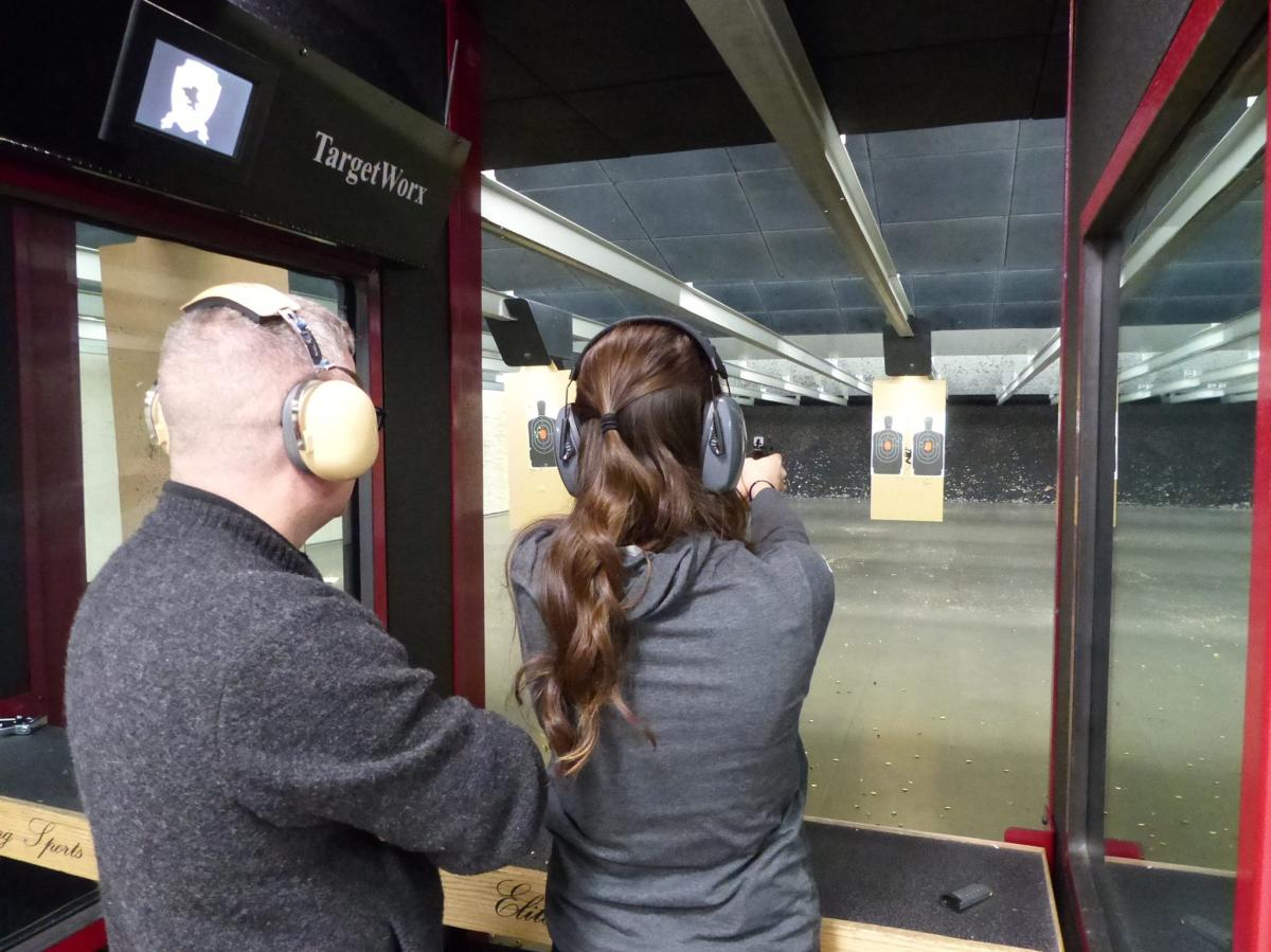 Couple target shooting at Elite Shooting Sports