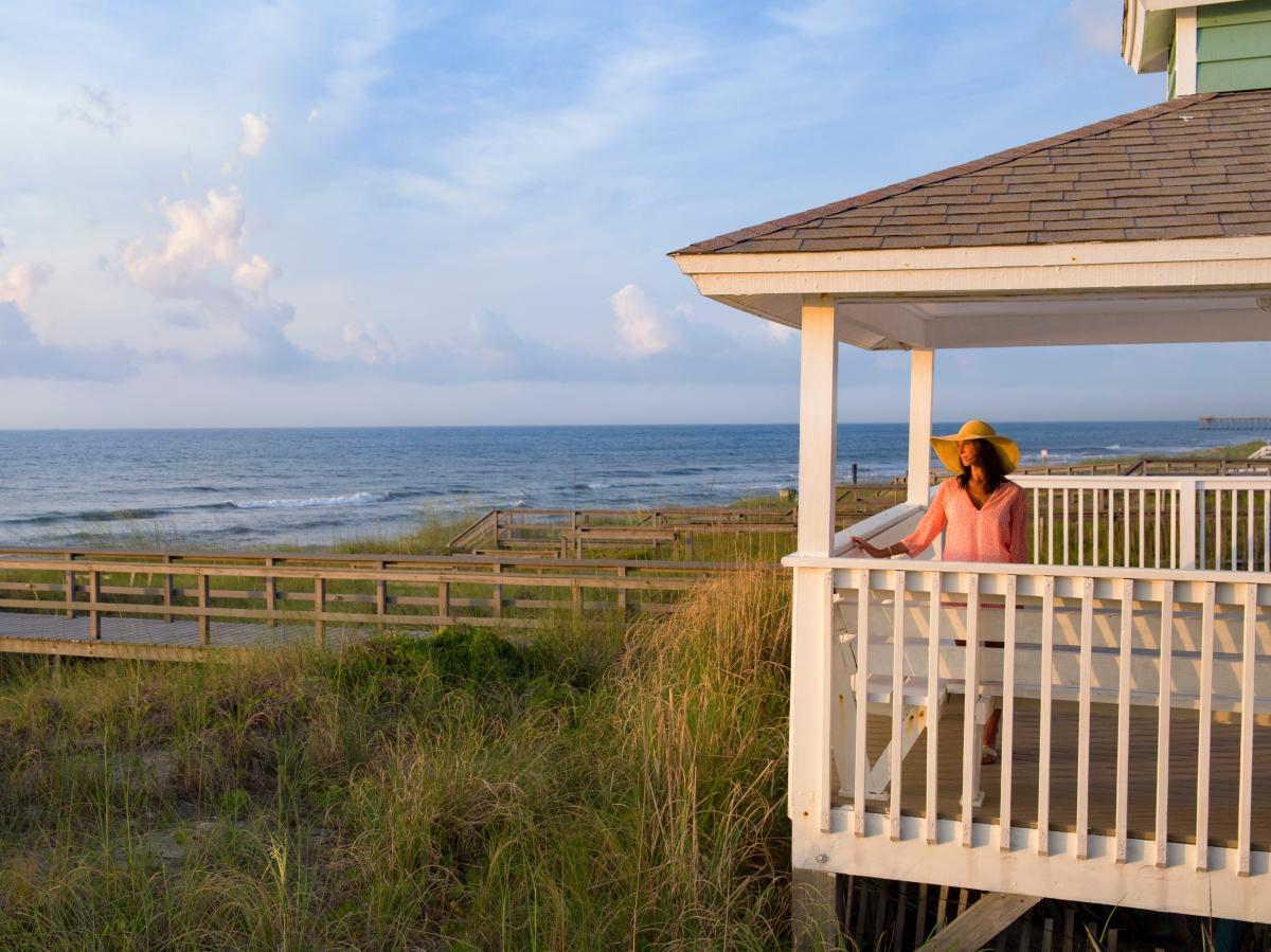 Woman On Beach House Balcony In Kure Beach