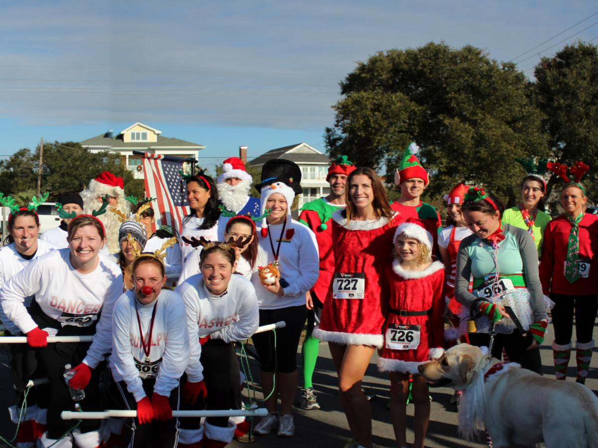 Participants of the Jingle Bell Run smiling for a group photo
