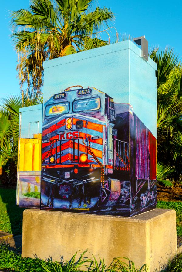 Traffic box showcasing the importance the railroads had on Sugar Land's development.
