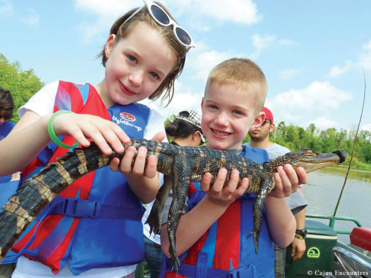 Kids with gator photo credit Cajun Encounters