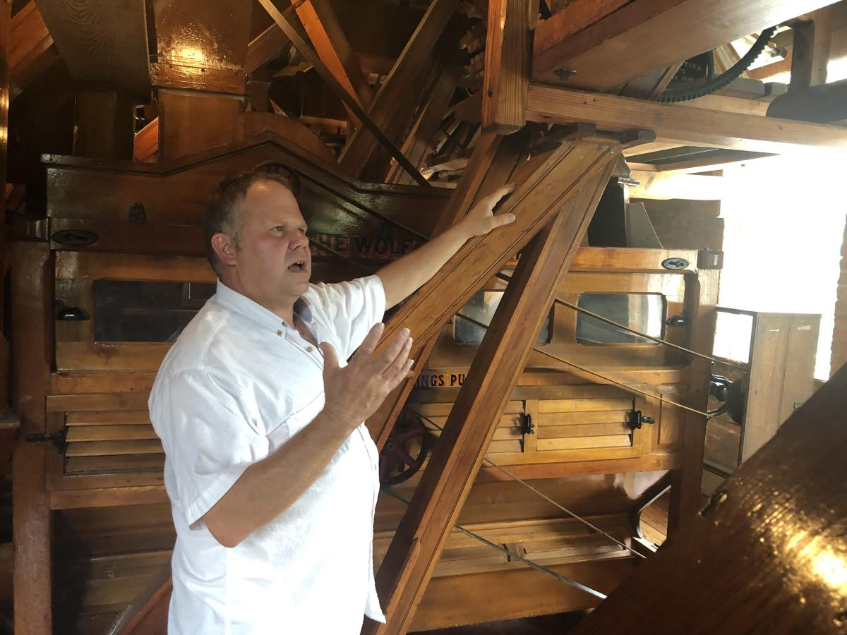 Man giving Smoky Valley Roller Mill Tour in Lindsborg, KS